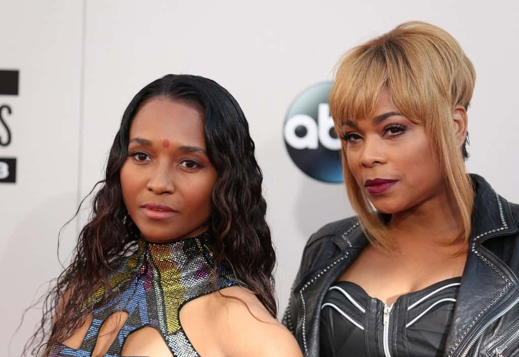 Chilli, left, and T-Boz of the musical group TLC arrive at the 2013 American Music Awards, on Sunday, Nov. 24, 2013 in Los Angeles. (Photo by Matt Sayles/Invision/AP)